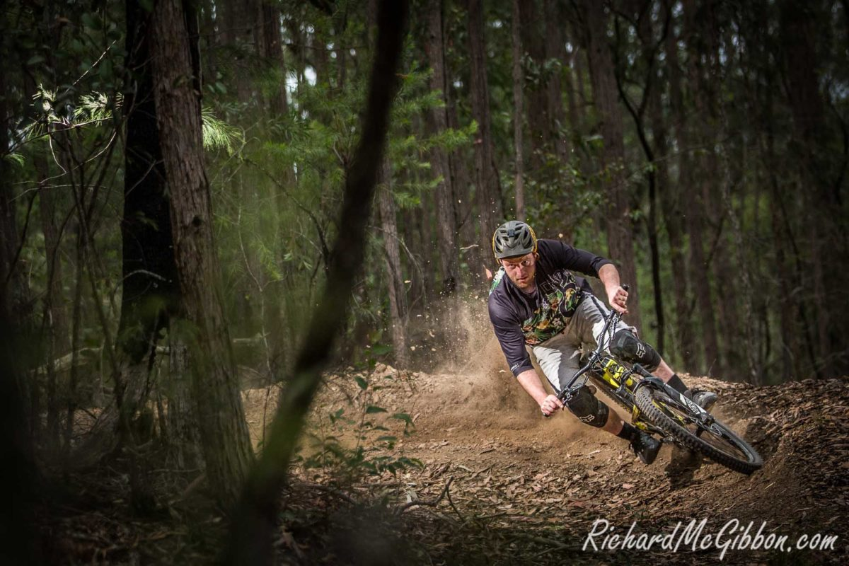 Trailshare's chief trail builder Josh Paul Smith testing his berms